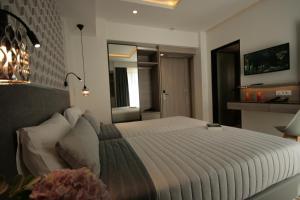 Letto o letti in una camera di Castro Beach Hotel