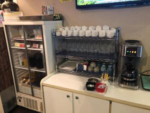 A kitchen or kitchenette at Hotel Peace Land