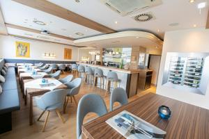 Ein Restaurant oder anderes Speiselokal in der Unterkunft Das Reinisch Business Hotel