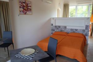 Letto o letti in una camera di Camping Villaggio San Giorgio Vacanze