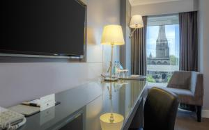 A television and/or entertainment center at DoubleTree by Hilton Bristol City Centre
