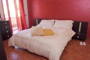 A bed or beds in a room at Casa di titti