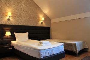 A bed or beds in a room at Hotel Oriza
