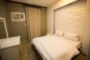 Cama ou camas em um quarto em Shams Alshate