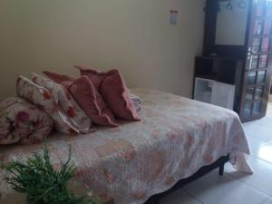 A bed or beds in a room at Pousada Rota do Parque