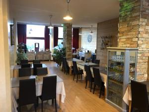 Restaurant ou autre lieu de restauration dans l'établissement Hôtel L'Escale Blanche