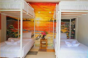 A bunk bed or bunk beds in a room at Tropical Garden Inn