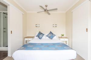 A bed or beds in a room at Holiday Haven Kangaroo Valley