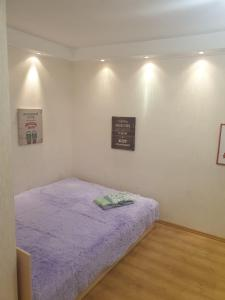 A bed or beds in a room at Apartment for Family and Friends in the Center of Novosibirsk