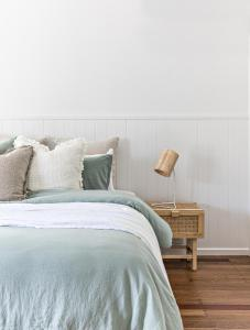 A bed or beds in a room at Cape Beach House