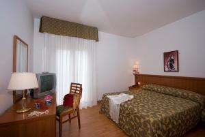 A bed or beds in a room at CiampinoHotel