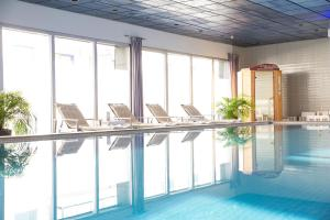 The swimming pool at or near Hotel Atlantic Hamburg, Autograph Collection