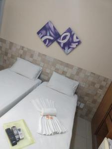 Кровать или кровати в номере Hotel Italia Beach