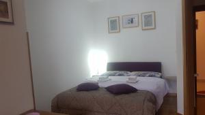 Krevet ili kreveti u jedinici u objektu Apartments Bosco