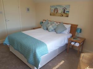 A bed or beds in a room at The Sea Croft Bed Breakfast & Bar
