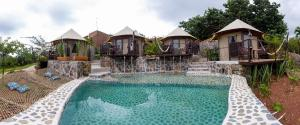 The swimming pool at or near Hostal de la Luz - Spa Holistic Resort