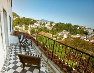 A balcony or terrace at Santa Teresa Hotel RJ - MGallery