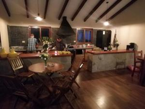 A restaurant or other place to eat at Hostel Serena