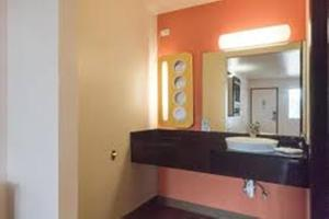 A bathroom at Motel 6-Brownsville, TX North