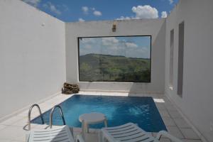 The swimming pool at or near Pousada Villa dos Leais