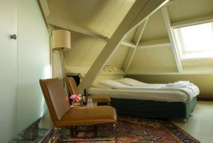 Een bed of bedden in een kamer bij Hotel Restaurant Oortjeshekken