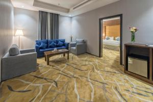 Uma área de estar em Sansa Hotel