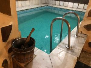 The swimming pool at or near Гостиница очаг