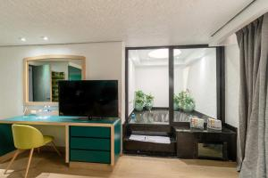A television and/or entertainment center at Hotel Embassy