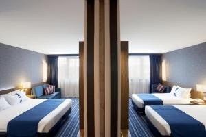 A bed or beds in a room at Holiday Inn Express Lisbon Airport, an IHG Hotel