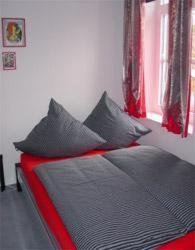 Ein Bett oder Betten in einem Zimmer der Unterkunft Hotel zur Eiche