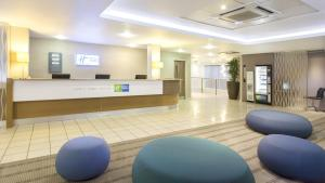 The lobby or reception area at Holiday Inn Express London Limehouse, an IHG Hotel
