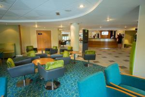 The lobby or reception area at Holiday Inn Express Liverpool-Knowsley, an IHG Hotel