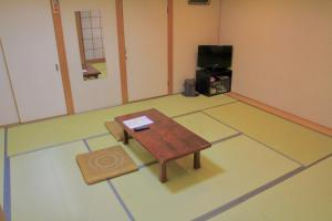A television and/or entertainment center at City Pension Tommy Rich Inn Kyoto