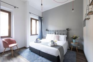 A bed or beds in a room at Hotel Miceli - Civico 50