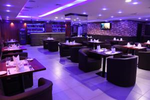A restaurant or other place to eat at Loumage Hotel & Suites