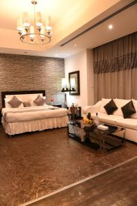 A seating area at Loumage Hotel & Suites