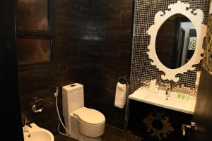 A bathroom at Loumage Hotel & Suites