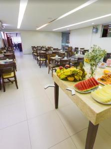A restaurant or other place to eat at Maktub Hotel