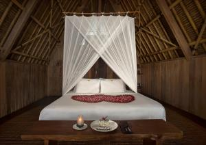 A bed or beds in a room at Jeeva Beloam Beach Camp