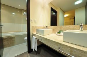Um banheiro em Villa Vergueiro Hotel
