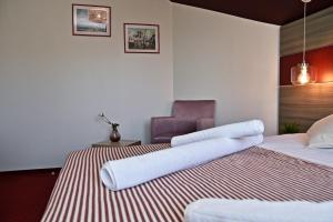 A bed or beds in a room at GreenWood Residence