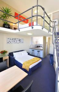 A bed or beds in a room at Metro Apartments On Darling Harbour