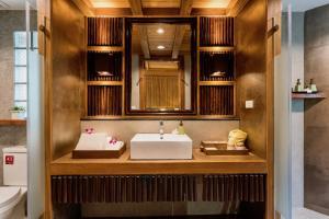 A bathroom at River Kwai Resotel - SHA Certified