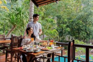 A restaurant or other place to eat at River Kwai Resotel - SHA Certified