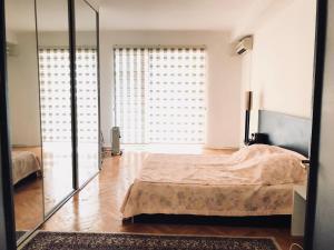 Cama ou camas em um quarto em Amazing Flat with Perfect Panorama in the City Center