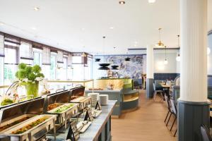 Ein Restaurant oder anderes Speiselokal in der Unterkunft MAXX by Steigenberger Sanssouci Potsdam