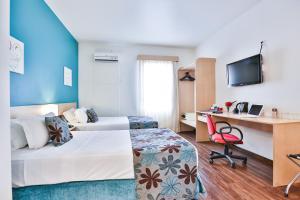 Cama ou camas em um quarto em Comfort Hotel Joinville