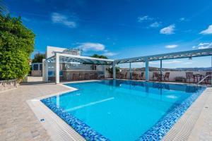 The swimming pool at or near Orizontes Studios