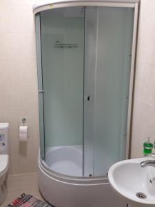 Ванная комната в Golfstream Hotel