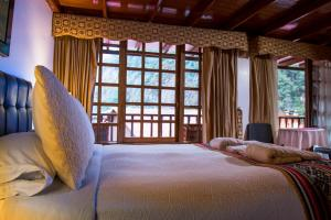 A bed or beds in a room at Gringo Bill's Boutique Hotel